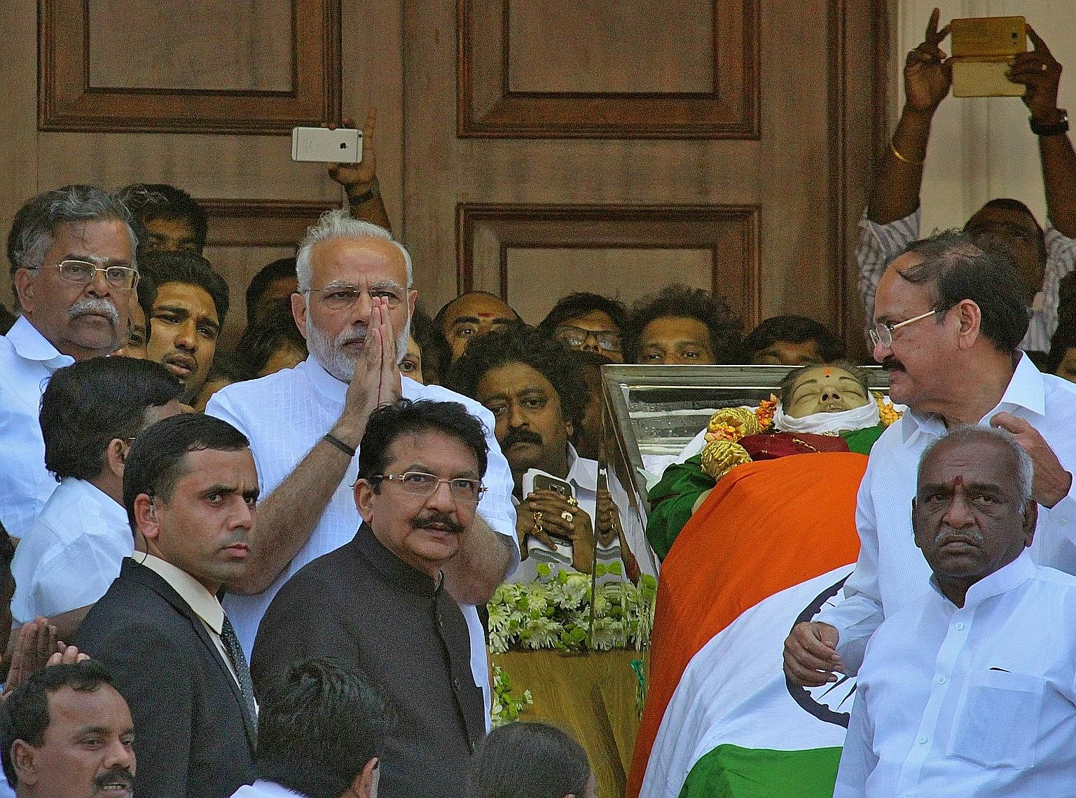 Indian Prime Minister Narendra Modi (with hands clasped), paying his respects to the late Tamil Nadu chief minister Jayalalithaa on Tuesday. Analysts believe Mr Modi has an early advantage in winning over a weakened AIADMK.