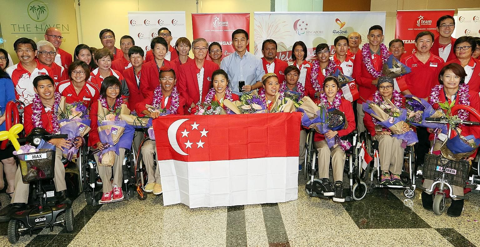Team Singapore's Paralympians in a group photo at Changi Airport on Sept 21. Giving all the para-athletes free or subsidised rides could ease their commute to and from training and spur them to continue doing their best.