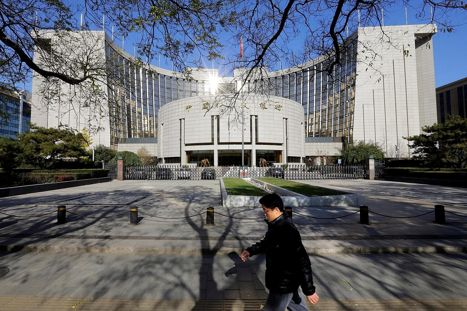 The Chinese acquisition of assets abroad has hurt the yuan. The People's Bank of China (above) has used its forex reserves to defend the currency, with the reserves dropping from nearly US$4 trillion in July 2014 to just more than US$3 trillion last