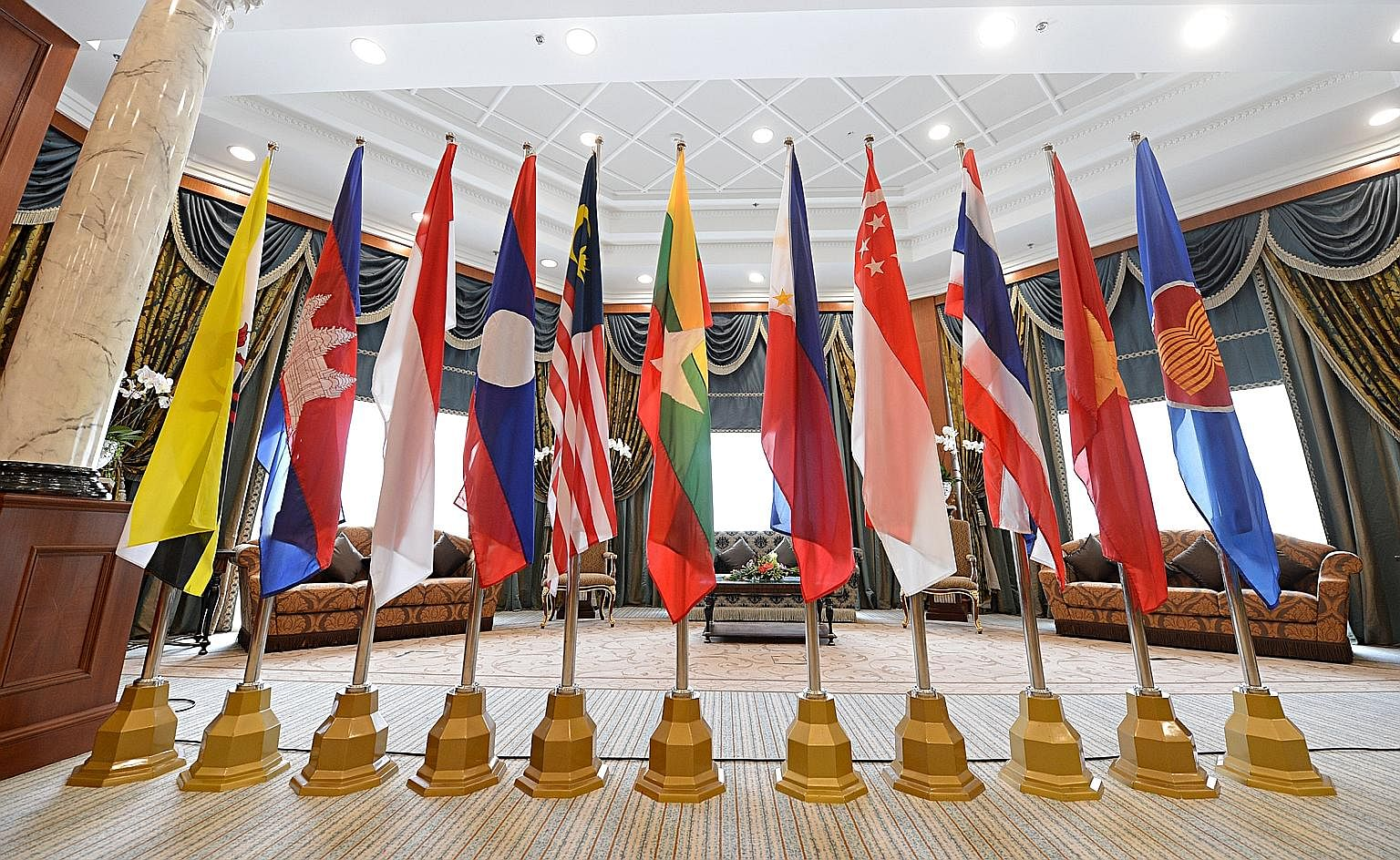 Flags of the Asean member states. It is important that the US continues to engage with Asean nations, even as China grows into a formidable power. Asean wants good relationships with both sides as it understands that better relations between all part