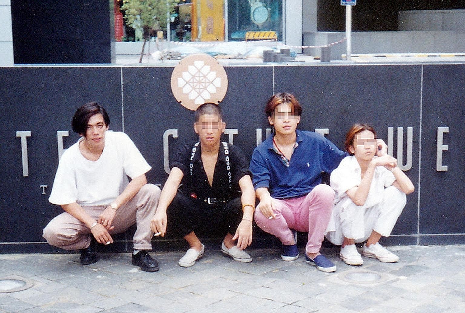 Mr Tan with students at the NUS Business School after giving a talk on social entrepreneurship. He also makes prison visits to counsel and encourage young inmates. Mr Tan (left) with friends in a photo taken when he was 21, just before he was sentenc