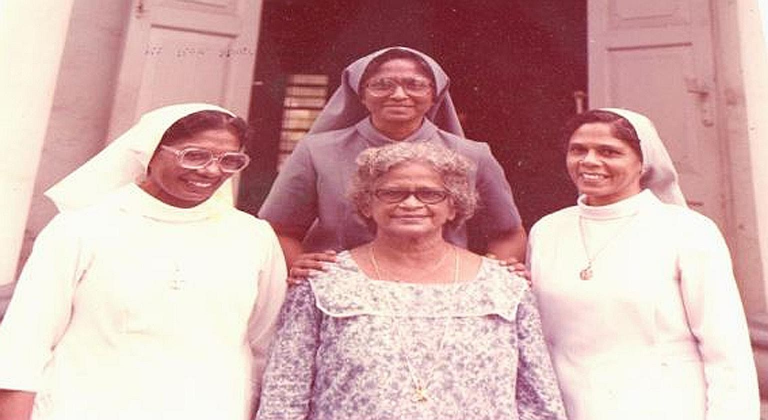 Sister Gerard (back row) with (from left) her elder sister Sadine, mother Mary Fernandez, and younger sister Victorine in the mid 1980s. Her sisters are Franciscan nuns.