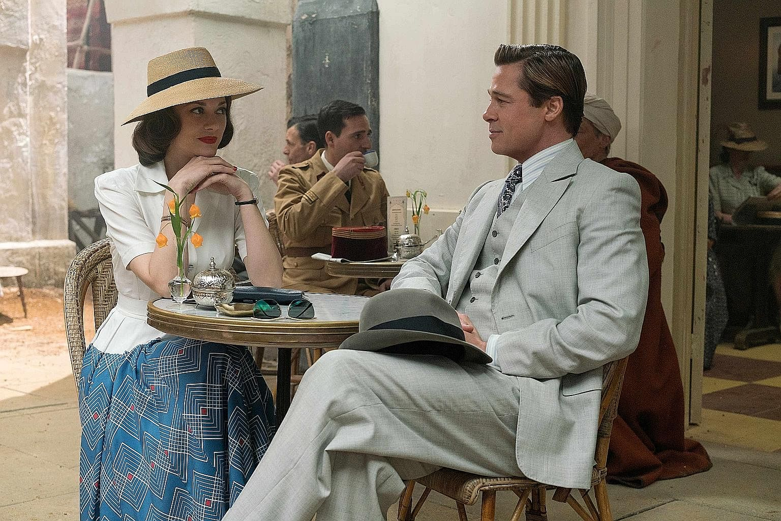 Gong Yoo in Age Of Shadows; Marion Cotillard and Brad Pitt in Allied (above); and Michael Pena, Kate Winslet and Will Smith in Collateral Beauty.