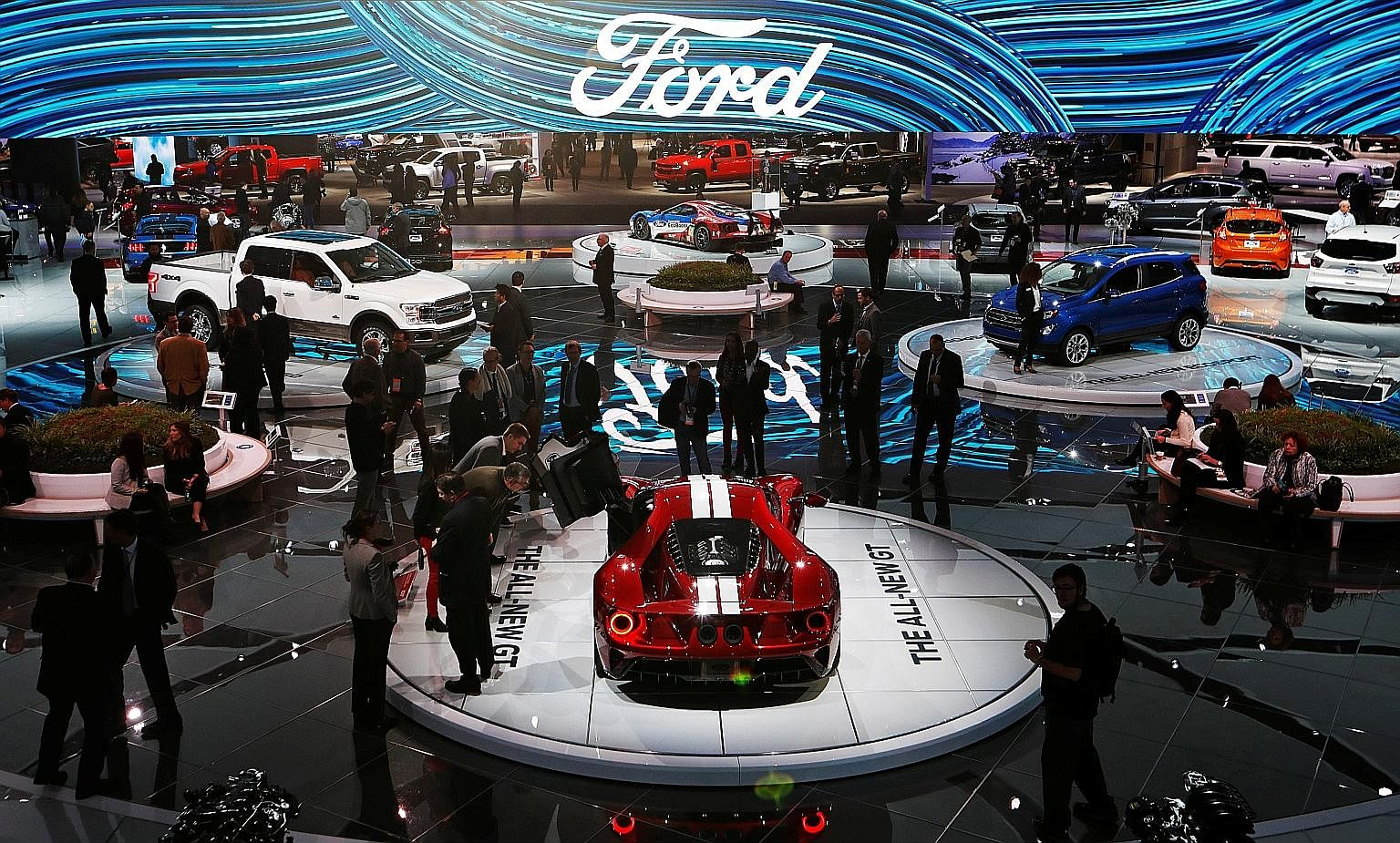 The Ford display at the North American International Auto Show in Detroit, Michigan, on Tuesday. The automaker's plan to invest $1 billion to build electric vehicles and create 700 jobs in Michigan is the latest sign that American companies expect th