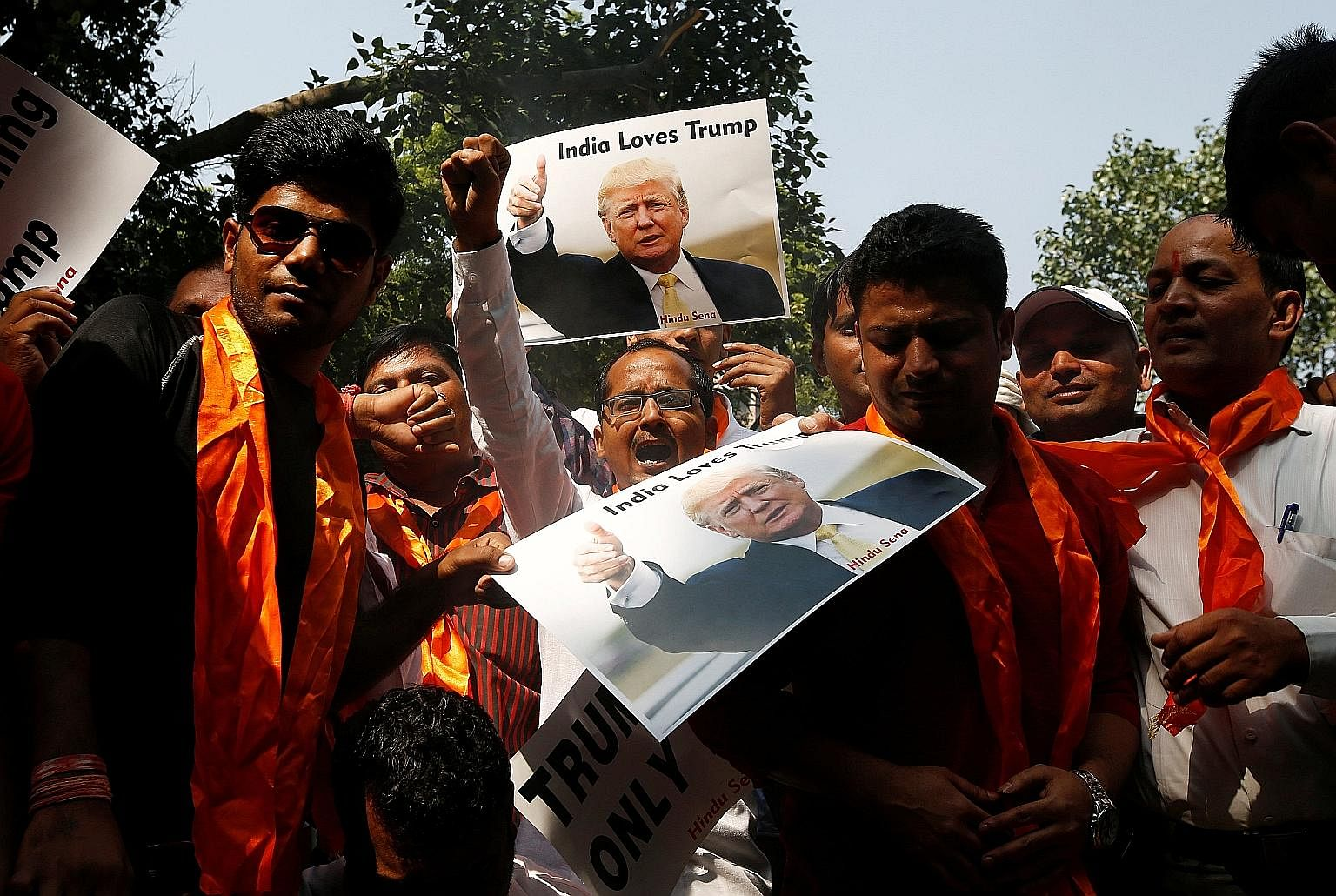 Members of a right-wing Hindu group at a pro-Trump demonstration in New Delhi last October. India should take advantage of Mr Trump's adversarial stance against China to develop equally good ties with China and the US, says the writer.