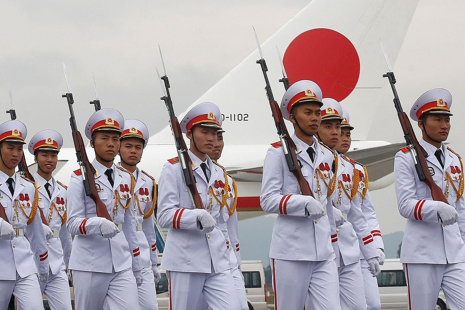 A Vietnamese honour guard in front of the plane transporting Mr Abe from Hanoi back to Tokyo yesterday. The Japanese leader's six-day regional tour also included the Philippines, Australia and Indonesia.