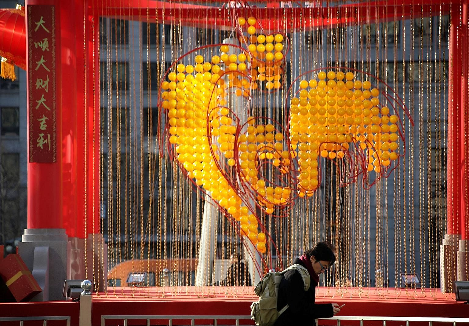 Decorations are up for the upcoming Year of the Rooster at the Oriental Plaza in Beijing. PO
