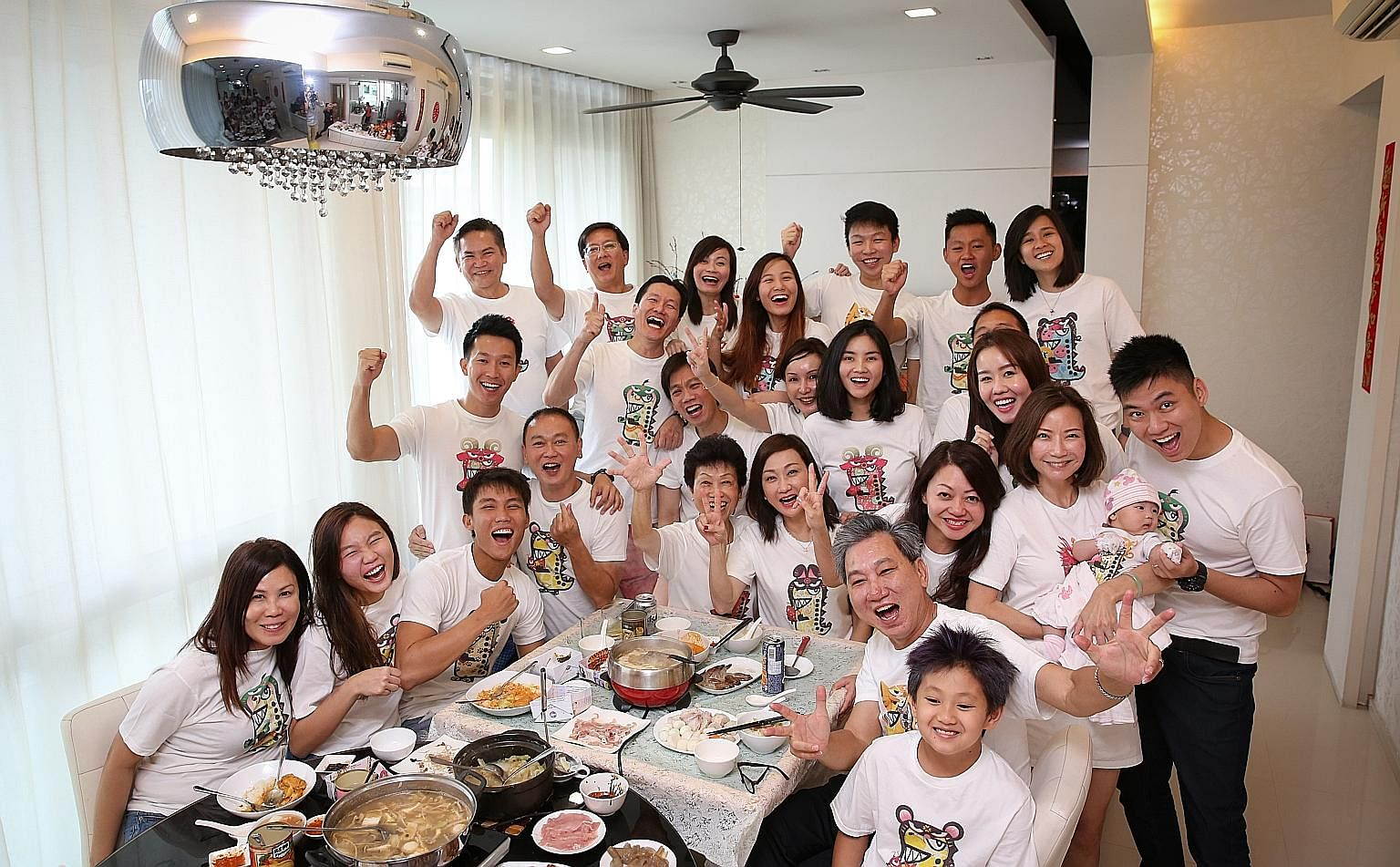 The Yeo family dressed in matching T-shirts bearing their respective zodiac signs at their reunion lunch yesterday. Twenty-six members of the family spanning four generations were present; two could not make it.