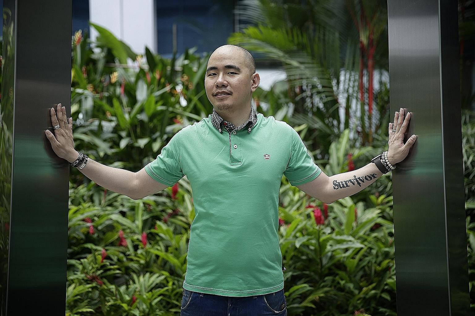 Mr Yip endured harrowing complications from treatment for his cancer, such as toxoplasmosis and partial paralysis. On his forearm is a tattoo of the word Survivor, which serves as a reminder of how he conquered his medical nightmare.