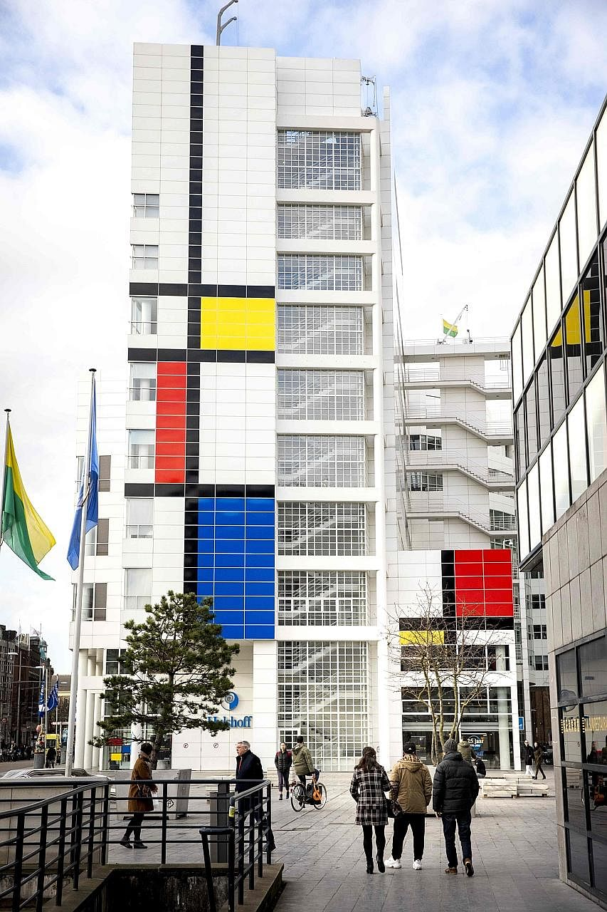 "The city hall in The Hague with its facade decorated with what Dutch officials describe as ""the largest Mondrian painting in the world""."
