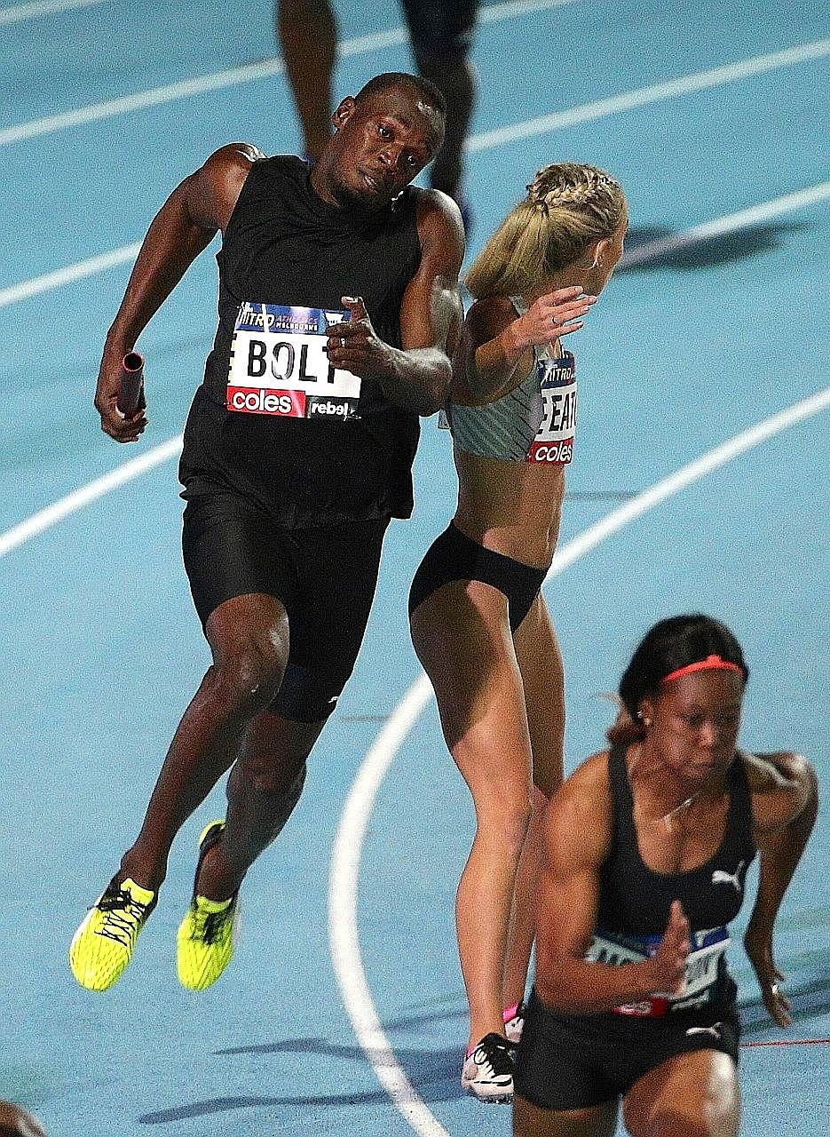 Olympic champion Usain Bolt collides with Team New Zealand's Olivia Eaton during the mixed 4x100m on the second night of the Nitro Athletics series, which saw six teams of 12 male and 12 female athletes compete in a mixture of old and new events. The