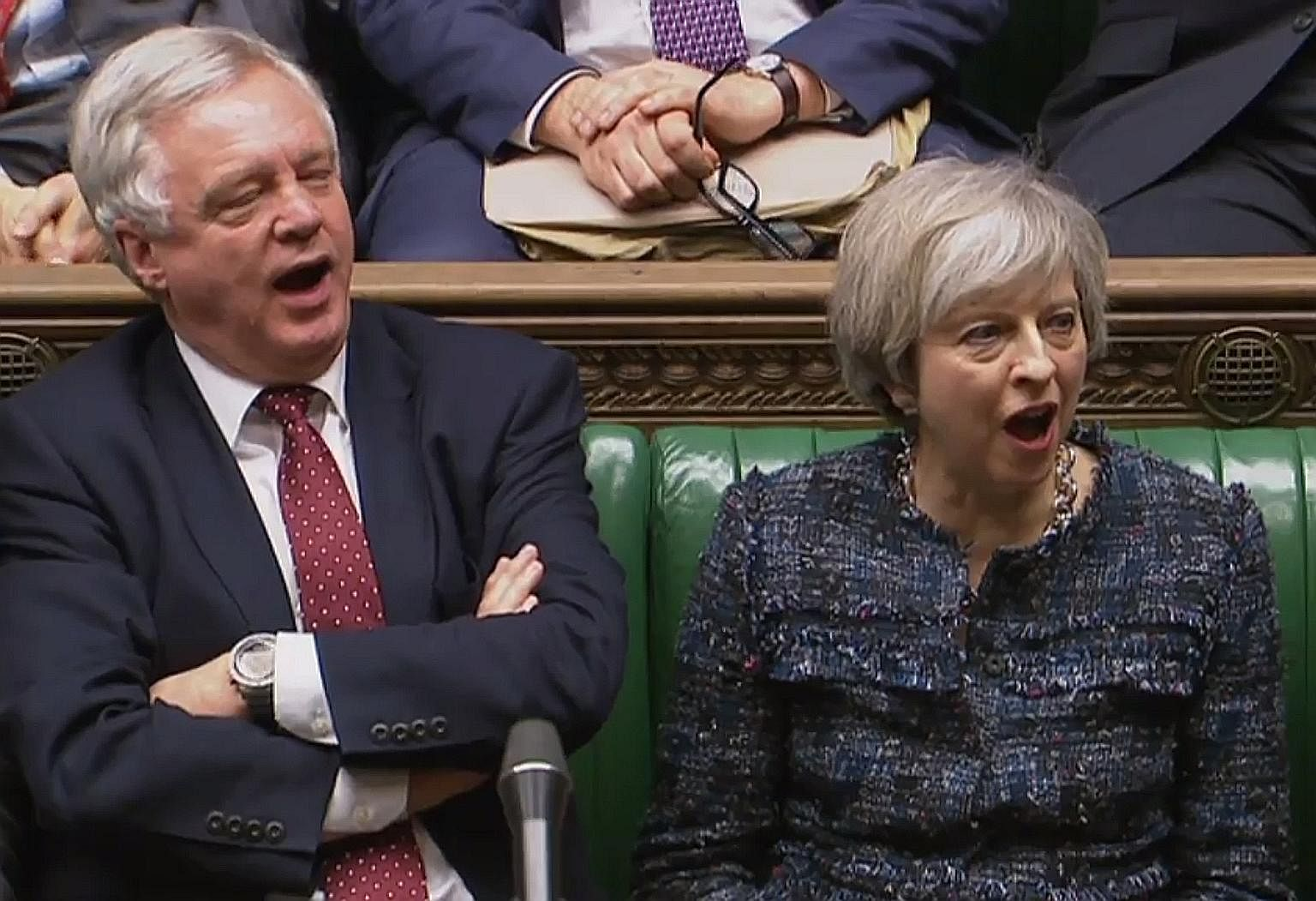 "Mrs May and Brexit Minister David Davis shouting ""aye"" during voting on Wednesday for a third reading of a Bill empowering the British Prime Minister to start Brexit negotiations. The Bill was approved in the House of Commons with a majority of 494 a"