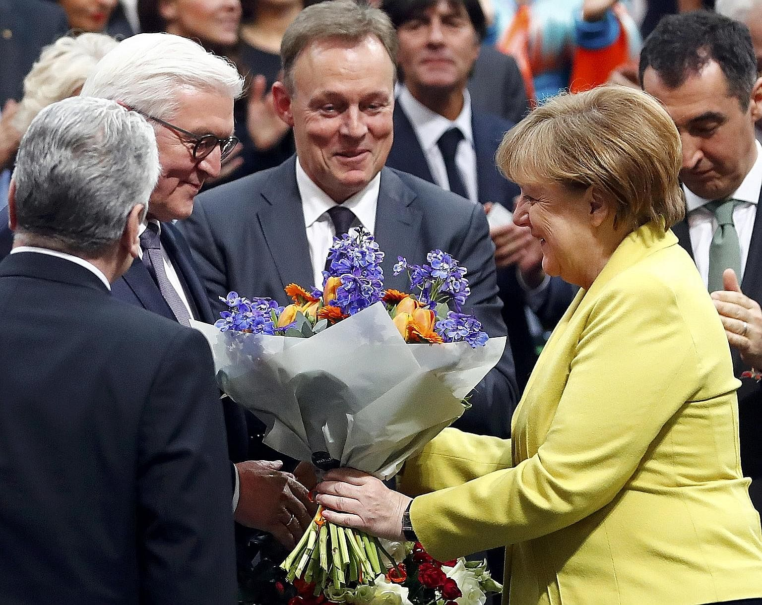 "Dr Merkel congratulating Mr Steinmeier on his election as Germany's president on Sunday. Instead of ""eliminating"" one rival in her bid for re-election, the Chancellor may have ""created"" another contender for the country's top post."