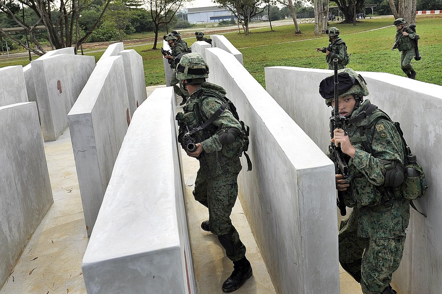 National servicemen during an obstacle-course training session. They will soon be trained in cyber-security tactics as well.