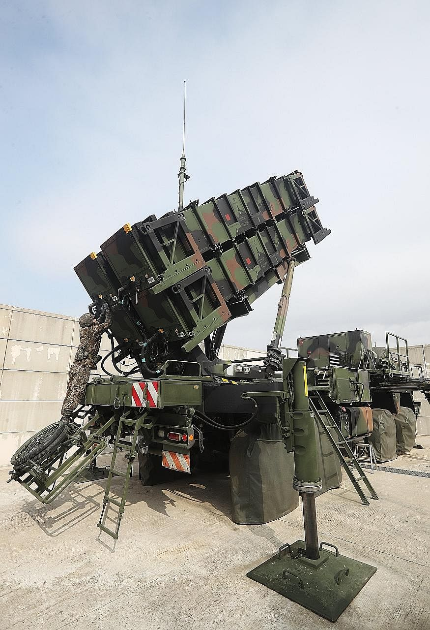 A soldier training on the launch pad of a Patriot PAC-3 advanced missile, at a unit