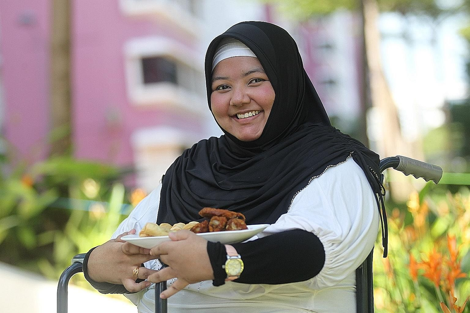Ms Noor Ain Masaid, who used to be bedridden, started her ChixCheese food business in 2007. Today, she is able to produce the food on her own and donates profits from some orders to those in need.