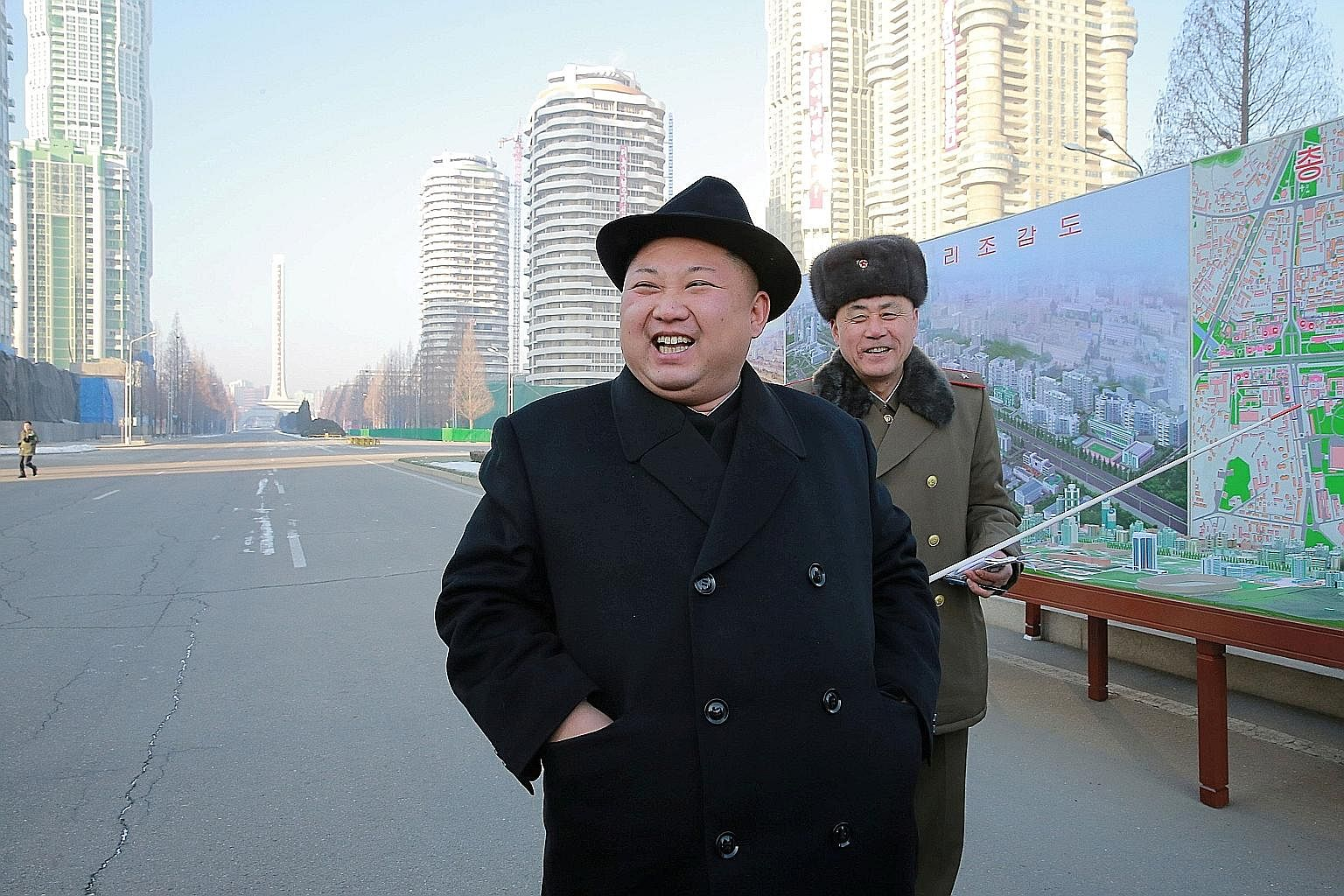 An undated photo of Mr Kim Jong Un inspecting a construction site, released by North Korea's Korean Central News Agency last month. Experts say he may have viewed his brother as a thorn and felt the need to eliminate him.