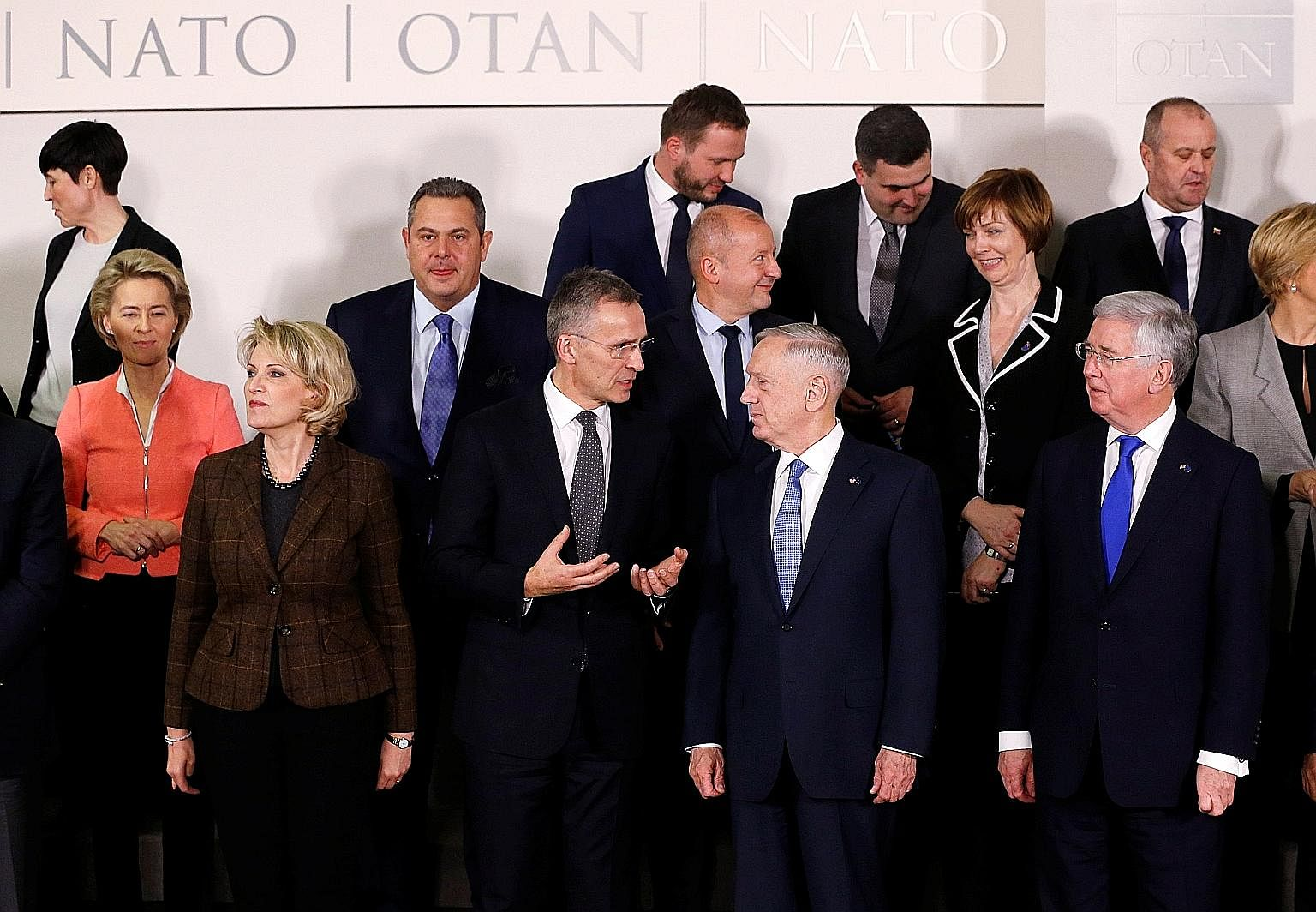 Nato Secretary-General Jens Stoltenberg (front row, second from left) speaking with US Defence Secretary James Mattis during a photo session with other Nato defence ministers at the alliance's headquarters in Brussels on Wednesday. Mr Mattis has the