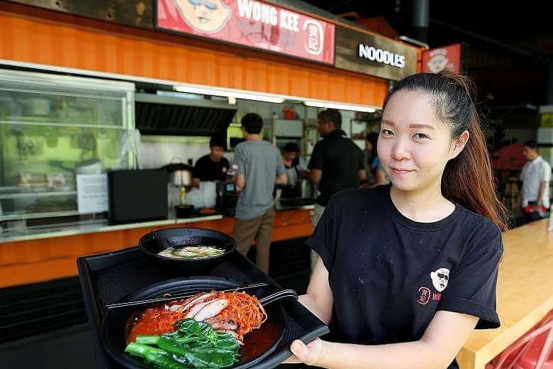 """Ms Wong with her tasty fare. """"I've been eating these noodles since I was young,"""" she says. Image: JONATHAN CHOO"""
