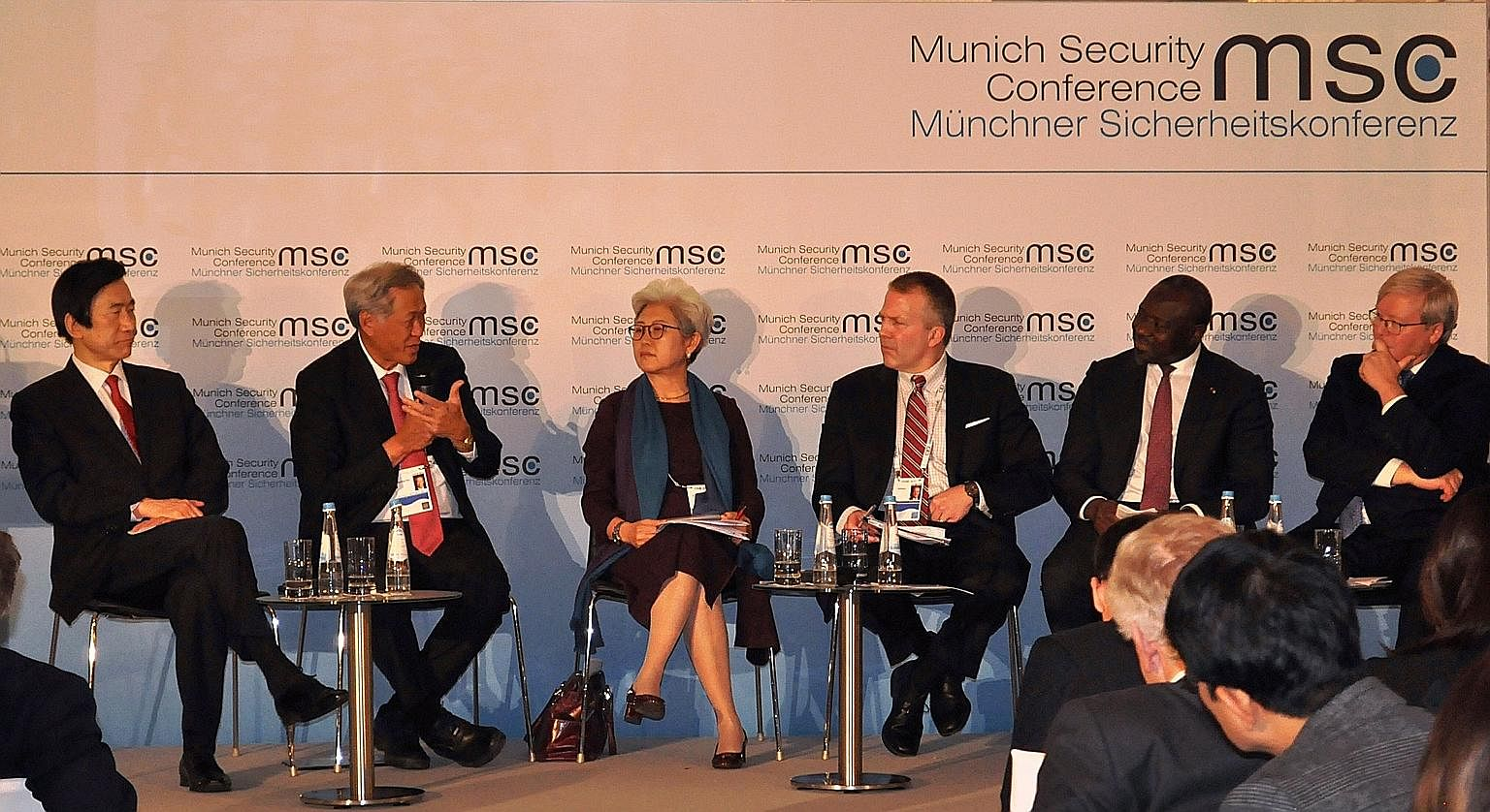 Defence Minister Ng Eng Hen (second from left) speaking at a panel during the Munich Security Conference last Saturday. The panel also included (from left) South Korean Foreign Minister Yun Byung Se, Ms Fu Ying, chairman of the Foreign Affairs Commit