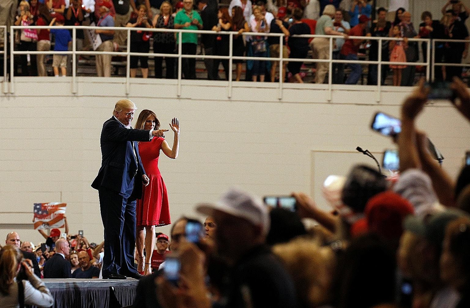 "Mr Trump and First Lady Melania Trump acknowledging supporters during a ""Make America Great Again"" rally in Melbourne, Florida, on Saturday. The American media does not seem to know how to cover the 45th President's signature style of declarative exa"