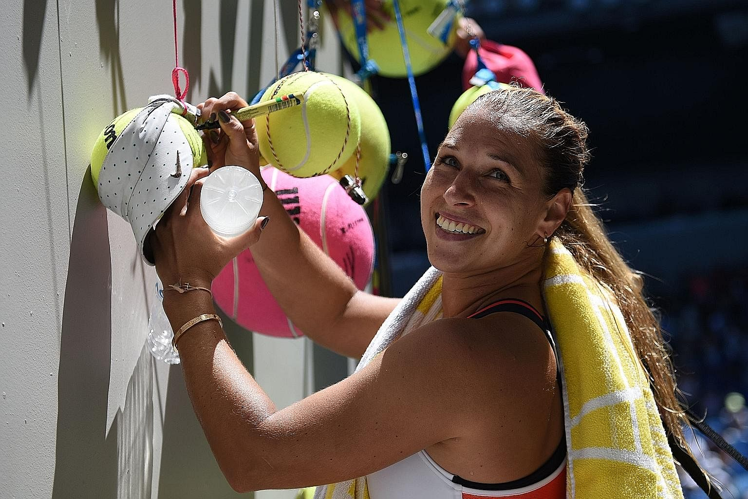 Slovakia's Dominika Cibulkova signing autographs at the Australian Open. The 27-year-old lost in the third round at Melbourne Park and is learning how to deal with the pressure of being the world No. 5.