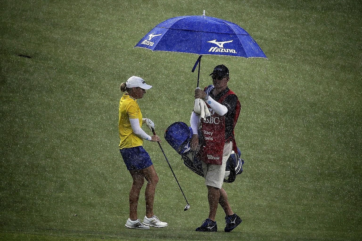 American Stacy Lewis battling the elements during the second round of the HSBC Women's Champions. The 2013 champion carded a one-over 73 yesterday, after a 68 on Thursday.