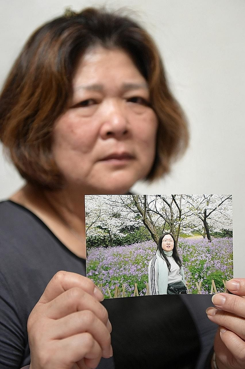 Madam Chen with a photo of her late daughter, Elsie. She is afraid her daughter's killer may go after the family after he is released from prison.