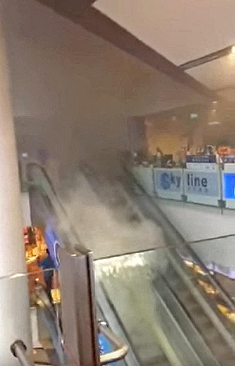 An unidentified person tried to use a fire extinguisher to put out the fire at the Chinatown Point escalator yesterday. An SCDF spokesman said the fire involved electrical wiring at the third-storey escalator landing, and there were no reporte
