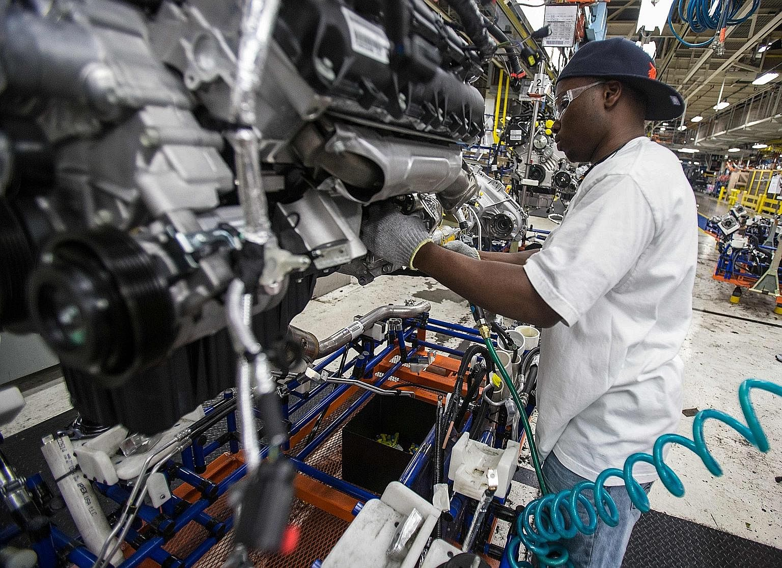 "The assembly line for Chrysler cars at the Jefferson North Assembly Plant in Detroit, Michigan. The narrative that ""good jobs"" in US manufacturing have been ""lost"" to competition from imports does not fit the facts, as imports create jobs too, says t"
