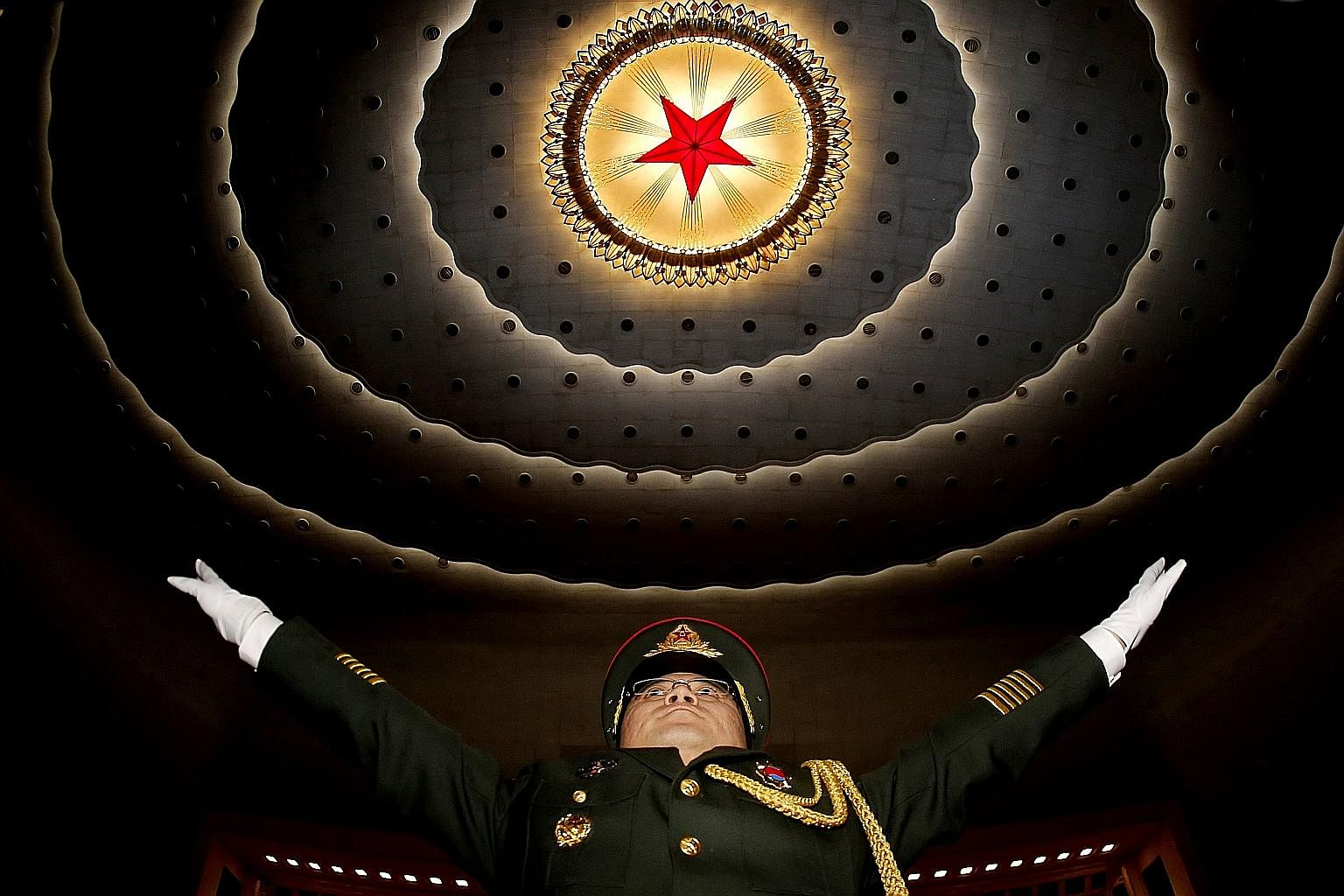 "A military band conductor at a rehearsal before the opening of China's ""two sessions"" - meetings comprising top legislative and consultative bodies. The policies made at these meetings aim to facilitate tax, finance and state-owned enterprise reforms"