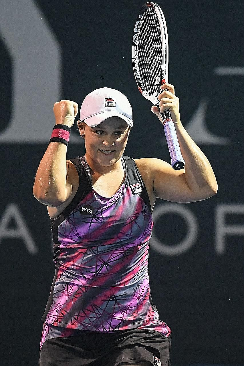 Ashleigh Barty pumping her fists after beating Japan's Nao Hibino 6-3, 6-2 in the Malaysian Open singles final. The Australian, a year into her tennis comeback after a stint playing cricket, also won the doubles title in Kuala Lumpur with compatriot