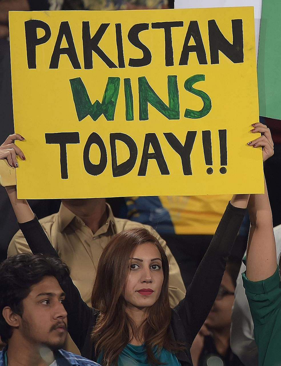 Peshawar Zalmi wicket-keeper Kamran Akmal stumping Quetta Gladiators batsman Muhammad Nawaz during the Pakistan Super League final at the Gaddafi Cricket Stadium in Lahore. A spectator holding a placard prior to the start. Peshawar captain