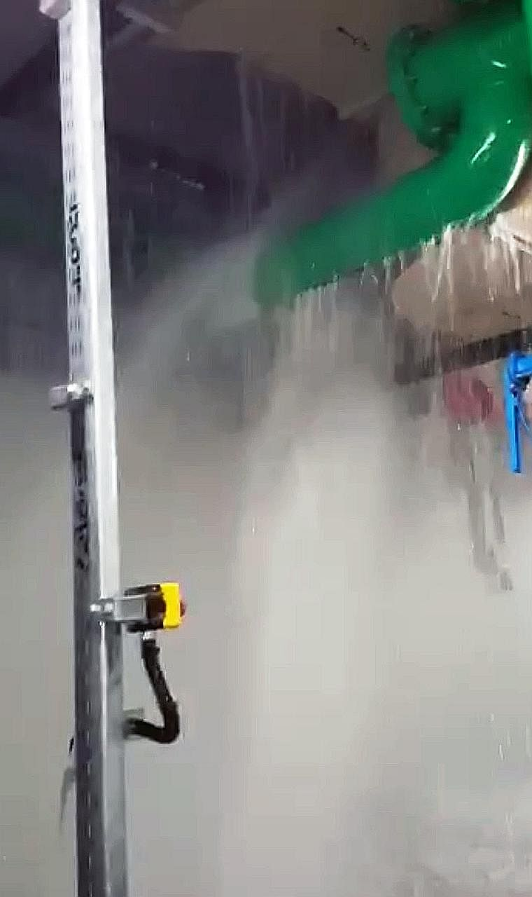 Still images from a video provided by a Straits Times reader show water gushing from a defective water pipe (above) in the yet-to-open Bencoolen MRT station and pooling. The fault has since been rectified.