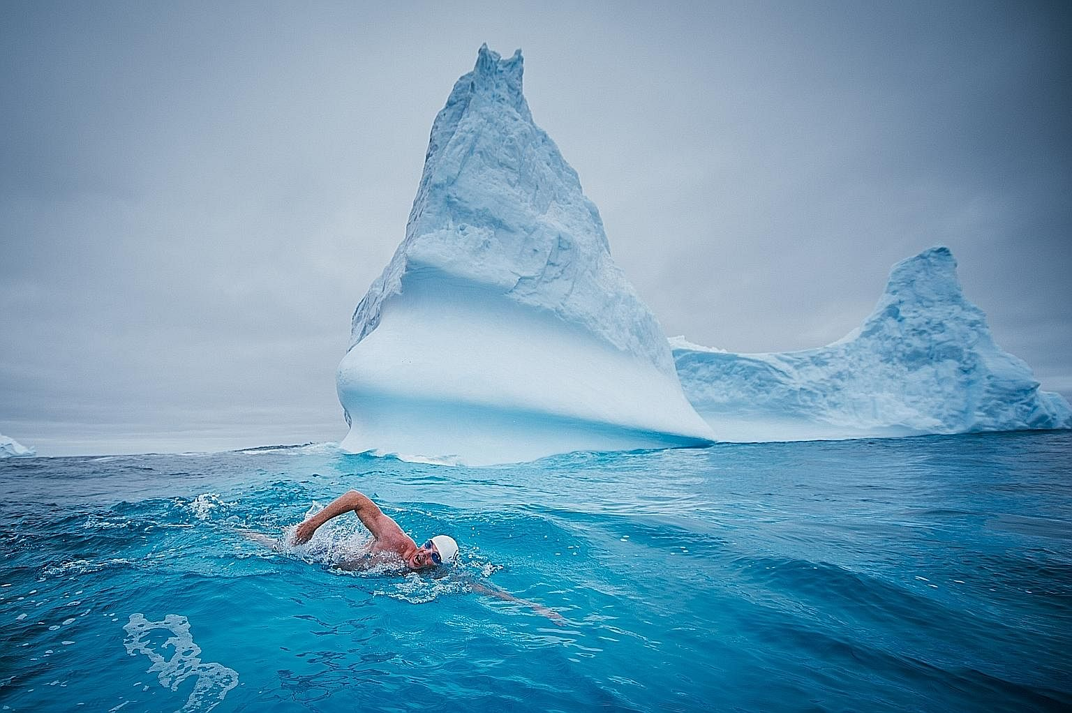 Mr Pugh swimming in the Antarctica. Through his swims, he hopes to secure more marine protection for the vulnerable seas in the Antarctic area, which collectively spans about 7 million sq km, roughly the size of Australia.