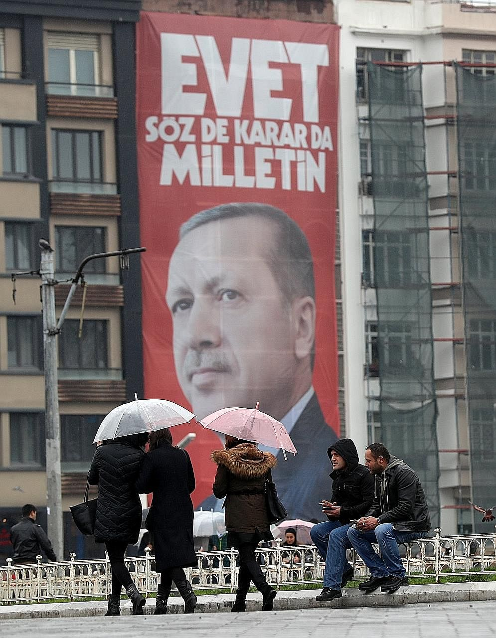 "A giant poster of Mr Erdogan in Istanbul's Taksim Square, which reads ""Vote yes, only the public can speak and make a decision"". A referendum next month seeks to grant him near-absolute power."