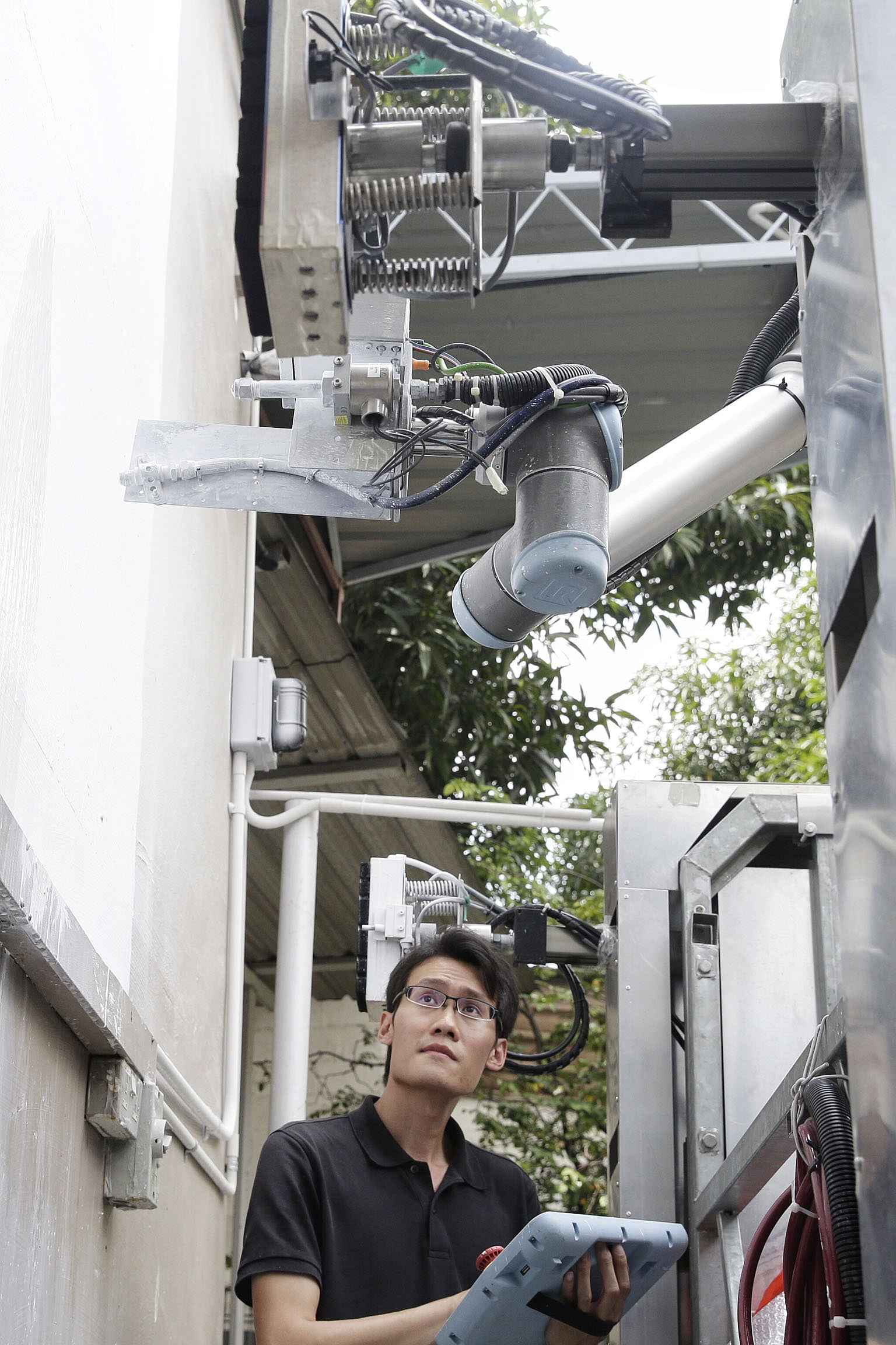 Robots that paint, clean HDB blocks to be tested shortly