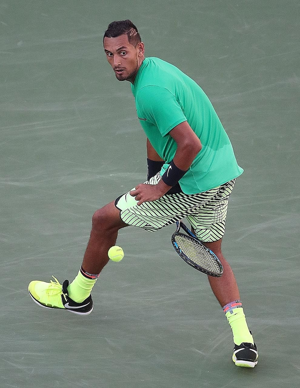 """Nick Kyrgios hitting a """"tweener"""", or a return between his legs, on the way to a 6-4, 7-6 (7-3) win against Novak Djokovic at the Indian Wells Masters on Wednesday. The Serb was bidding for a fourth straight title in the Californian desert, but fell t"""
