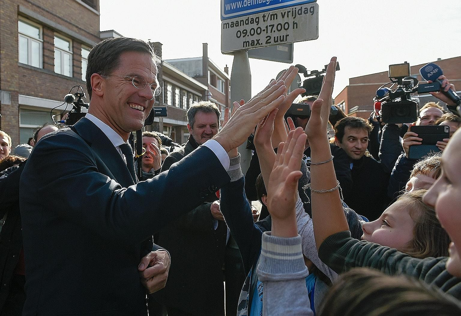 "The Netherlands' Prime Minister and VVD party leader Mark Rutte after casting his ballot at a polling station in The Hague on Wednesday. ""The Netherlands, after Brexit and the American elections, said 'stop' to the wrong kind of populism,"" he told su"