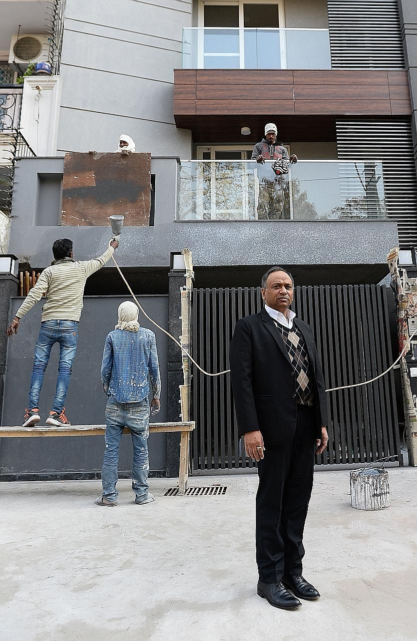 Indian real estate lawyer Naresh Gupta outside a newly built house in New Delhi. A new law will end the practice of putting real estate in someone else's name to avoid paying tax.