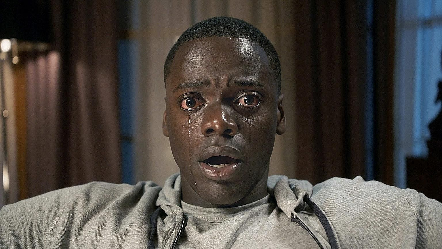Daniel Kaluuya plays a man whose life takes a horrific turn after visiting his white girlfriend's liberal parents in the thriller, Get Out.