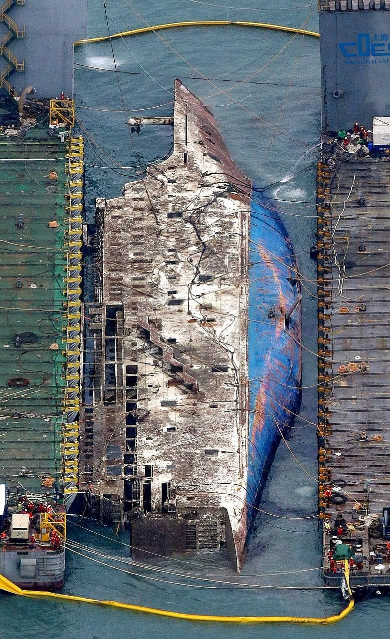South Korea's Sewol ferry emerging from the waters yesterday nearly three years after it sank with 304 people losing their lives in one of the country's worst maritime disasters. The complex operation involving 450 workers was one of the largest rais