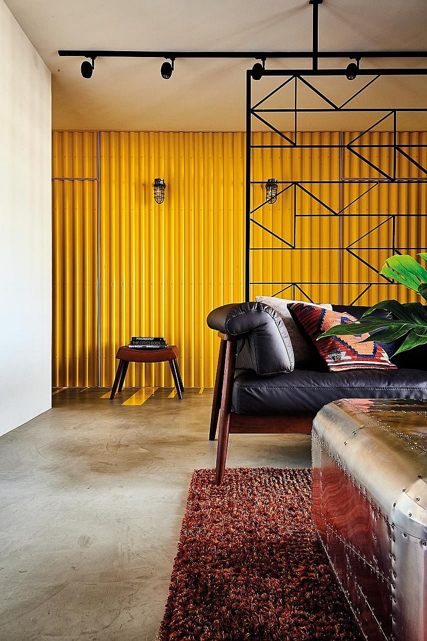 A bright yellow 'cargo container' forms the backdrop to the living room.