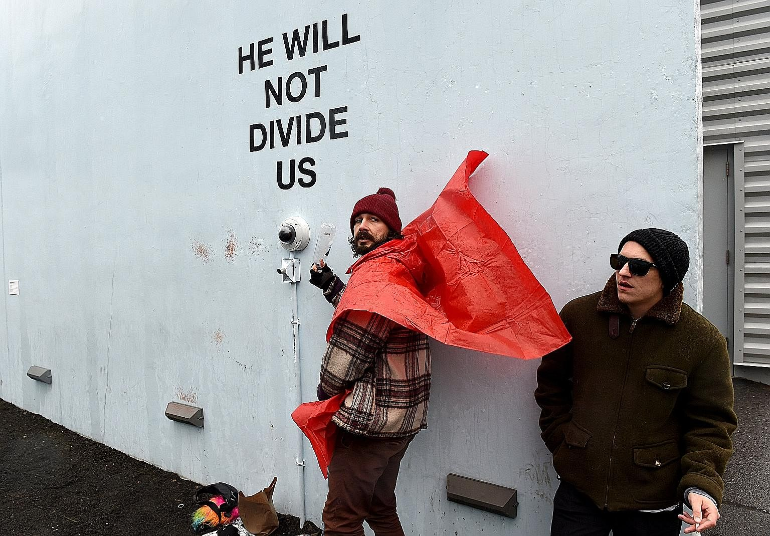 "American actor Shia LaBeouf (left) during a livestream of his ""He Will Not Divide Us"" project in New York on Jan 24. The project has had to relocate for the fourth time due to disruptions by 4chan users."