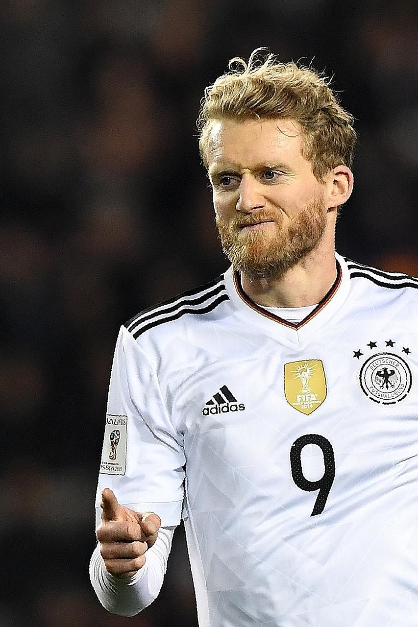 Germany's Andre Schurrle celebrates the first of his double in a less-than- vintage 4-1 win over Azerbaijan.