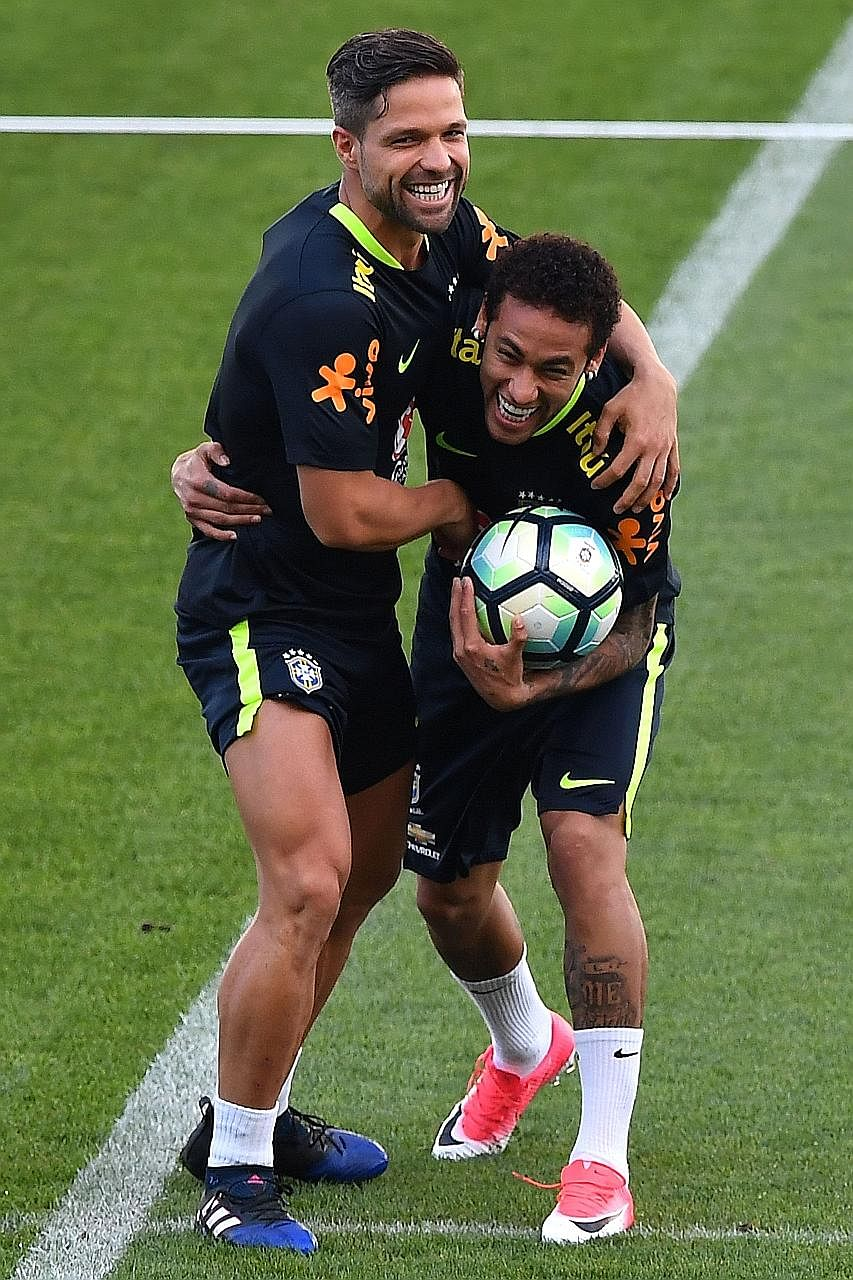 Brazil's Diego (left) and Neymar are all smiles at a training session before their 2018 World Cup qualifier against Paraguay. The Selecao can seal their place in Russia with a win over Paraguay, and if both Ecuador and Chile lose their respective gam