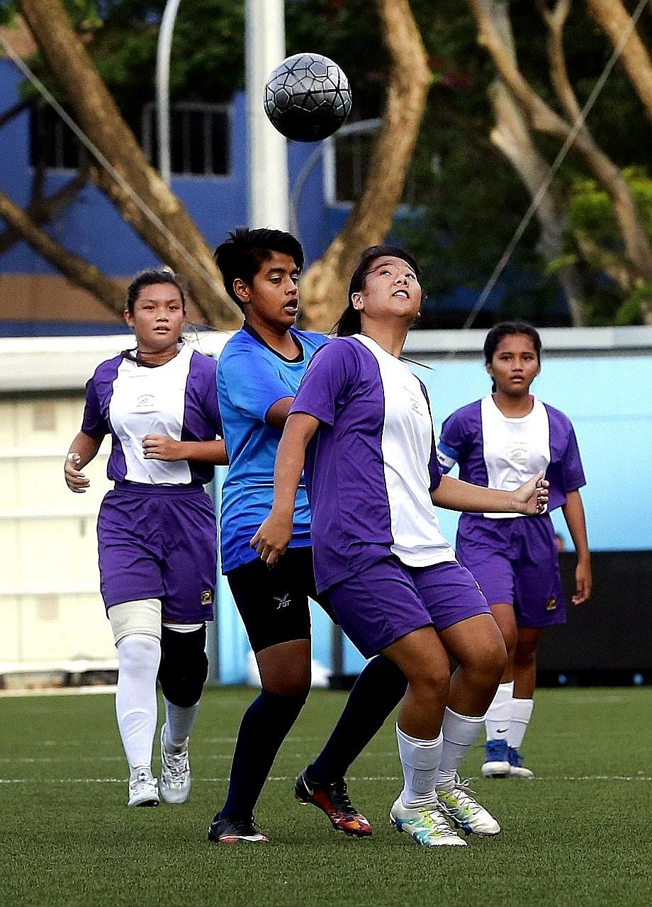 Queensway (purple) competing against Bowen in the B Division girls' football final. Bowen beat Queensway to retain their crown.