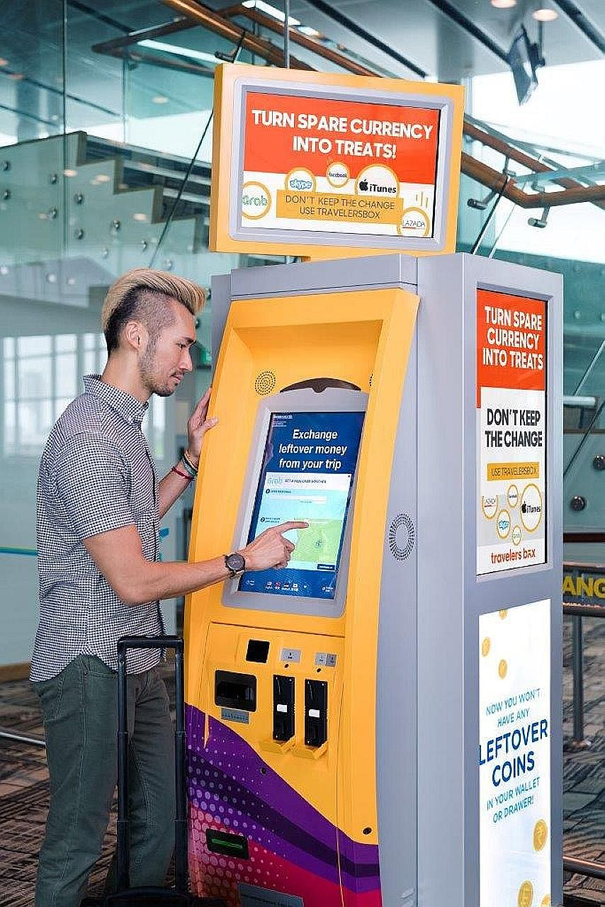 """Mr Lim Jing Rong, Mr Goh and Mr Gay founded RateX, which aims to """"flatten"""" cross-border online shopping by offering real exchange rates. TravelersBox has kiosks at Changi Airport which let travellers convert their leftover foreign currency"""