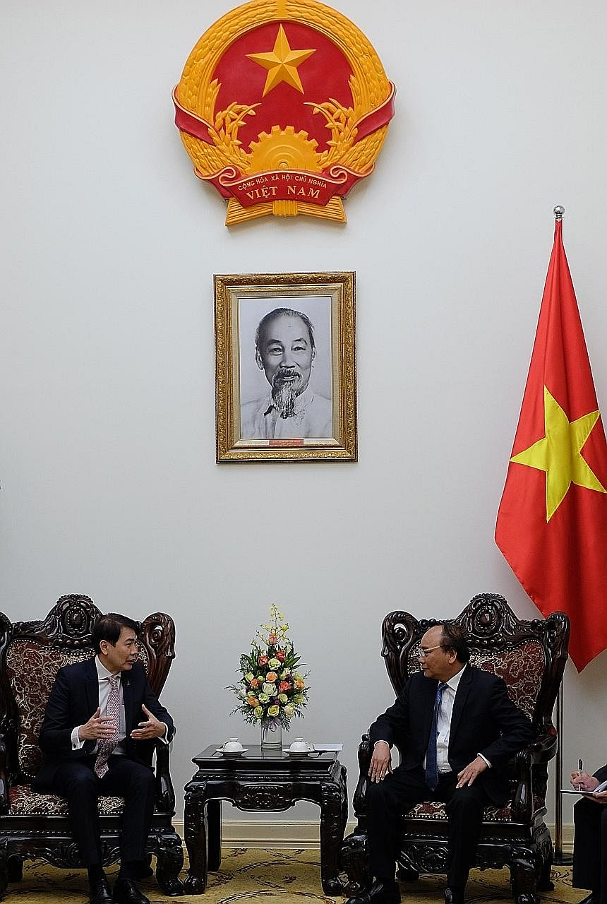 CapitaLand's Mr Lim (left) with Mr Phuc, Vietnam's Prime Minister, yesterday. The developer sees great potential in the country.