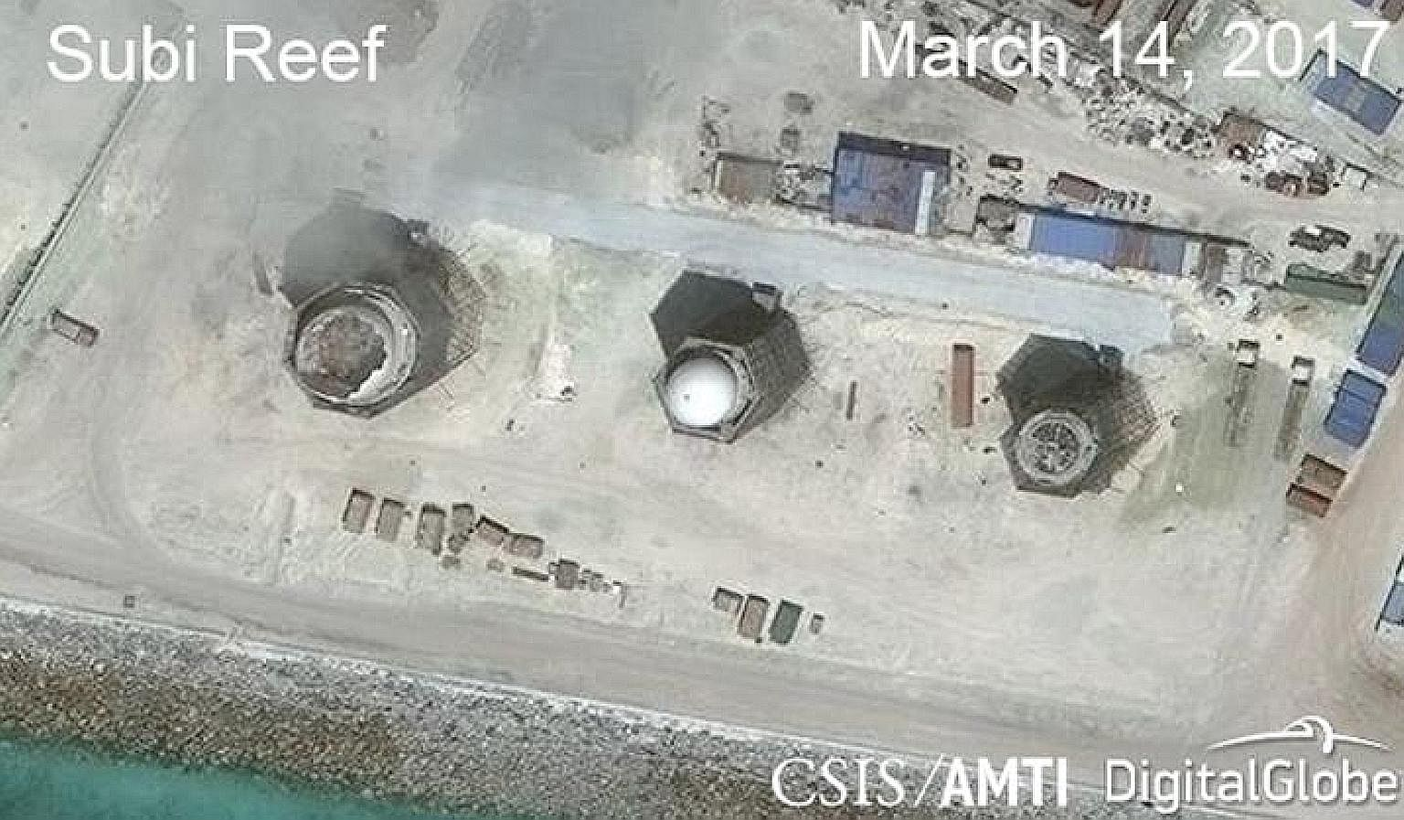 Structures seen in satellite images of (from far left) Subi Reef, Mischief Reef and Fiery Cross Reef in the Spratly Islands.